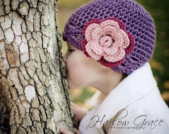 Child size flower hat in dusty purple with pink and dark pink flower