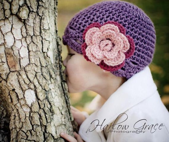 Infant size scalloped flower hat in dusty purple with pink and dark pink flower