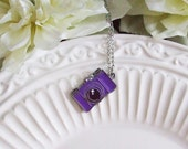 4 dollar sale . purple enamel camera necklace
