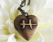zodiac heart locket necklace . bronze . pisces