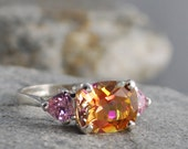Twilight Topaz cushion ring with pink heart accents