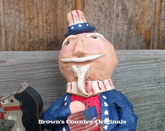 Paper Mache Uncle Sam on his Wooden Horse PM192