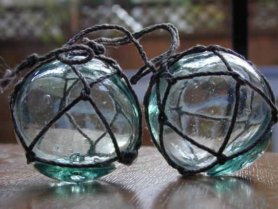 VENUS IN SIAM, PAIR OF TWIN ANTIQUE HAND BLOWN GLASS FISHING FLOATS, PERFECT WINDOW SILL COLLECTORS WITH AUTHENTIC NETS