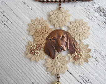 DOG finding and lace brooch