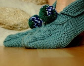 Knitted slippers light sage green with big pom poms.