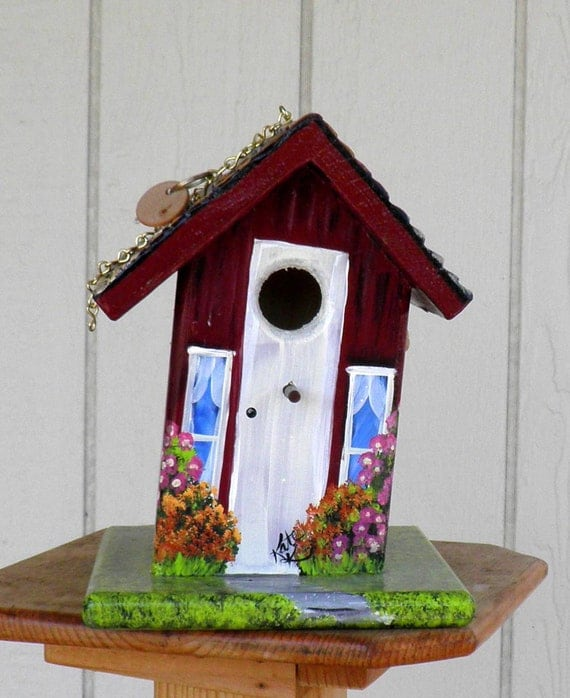 Birdhouse Blessings has Handcrafted and Hand Painted a Cranberry Red Birdhouse with lots of Flowers