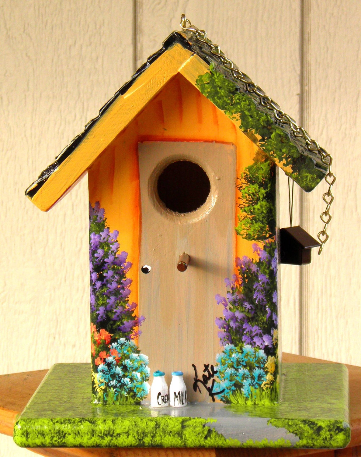 hand painted bird house orange with colorful flowers
