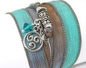 Hand Dyed Silk Wrap Bracelet -Creme de Mint with Pewter Triskele, Goddess, and Aqua Swarovski Crystals