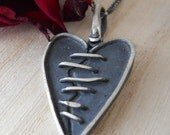 torn heart pendant, sterling silver,  hand forged