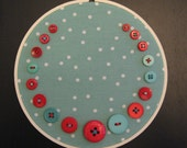 red and aqua button embroidered wall art