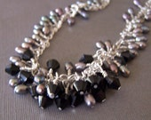 Let the Pearls and Crystals Fall as they may ......Now on sale..  A pearl and black crystal cluster hand wrapped necklace.