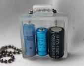 Glowing Batteries OOAK fully handmade resin pendant that glows unisex