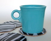Reversible Round Oilcloth and Cork Coasters in zebra stripe, set of four