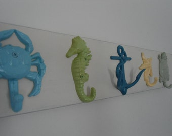 Interior design beach cottage renovation outdoor towel rack hot tub pool coastal decor rack mermaid crab starfish turtle BeachHouseDreamsOBX