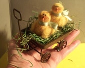 Two Woolie Chicks in a Rusty Wagon