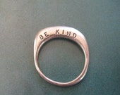 Silver 'Be kind' ring.