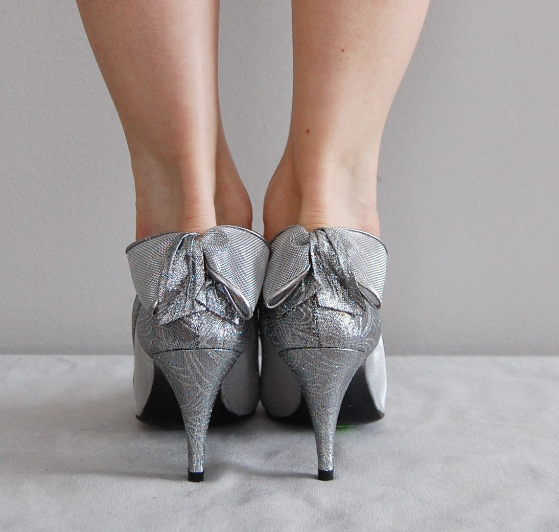 Silver Heels With A Bow