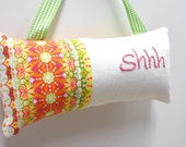 Shhh pillow- doorknob pillow hand embroidered on linen-with bright stripes, yellow, orange, green, pink, quiet