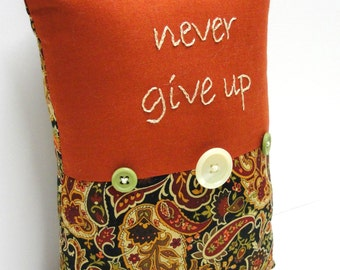 "hand-embroidered pillow - ""never give up"" on rust with black paisley and buttons, Ready to ship"