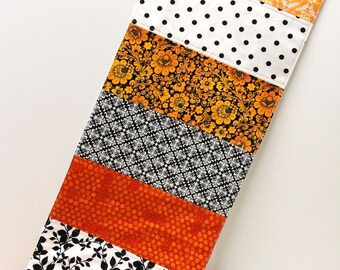 """Halloween table runner- """"All Hallows Eve"""" in orange, black, white and yellow- contemporary, Ready to ship"""