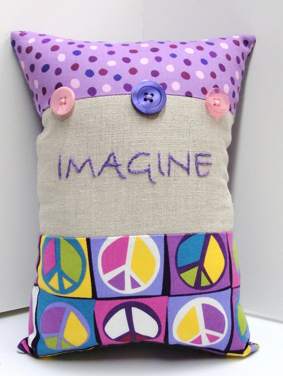 """hand embroidered  """"Imagine"""" pillow in purples, yellows, pinks & blues- peace"""