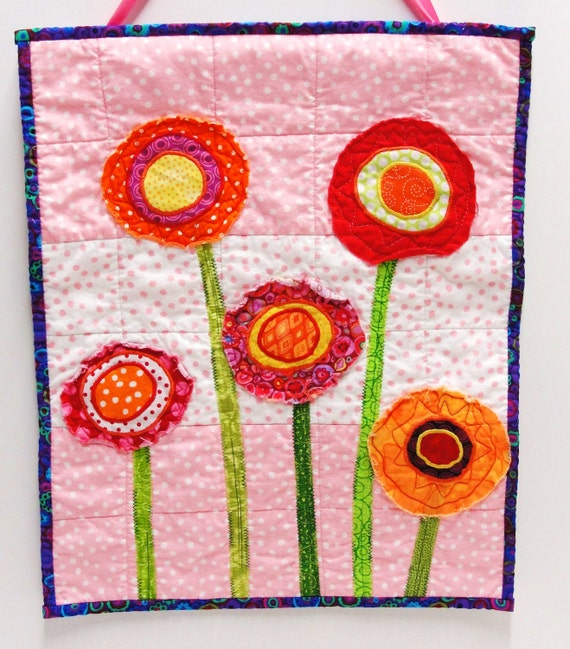 poppy quilt- wall art quilt- 5 stems in red, orange, yellow and pink