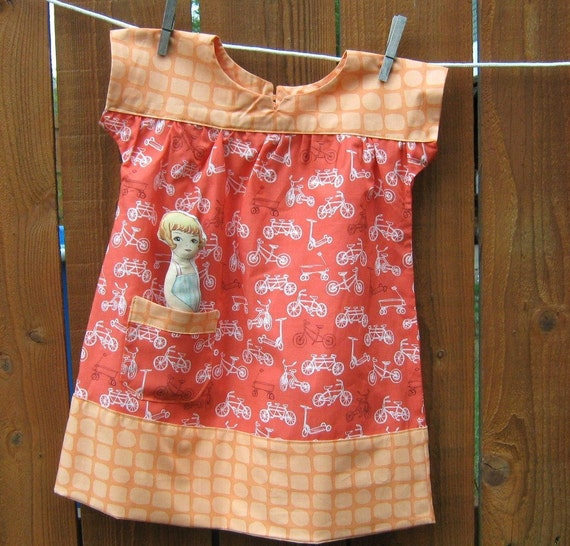 Girls Dress  Orange Bike , Doll In The Pocket , Size Three