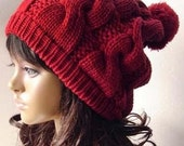 Beautiful red beanie wool hat with lovly pompon