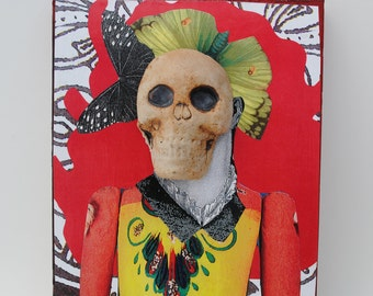 mixed media assemblage art collage on wood mexican skull doll