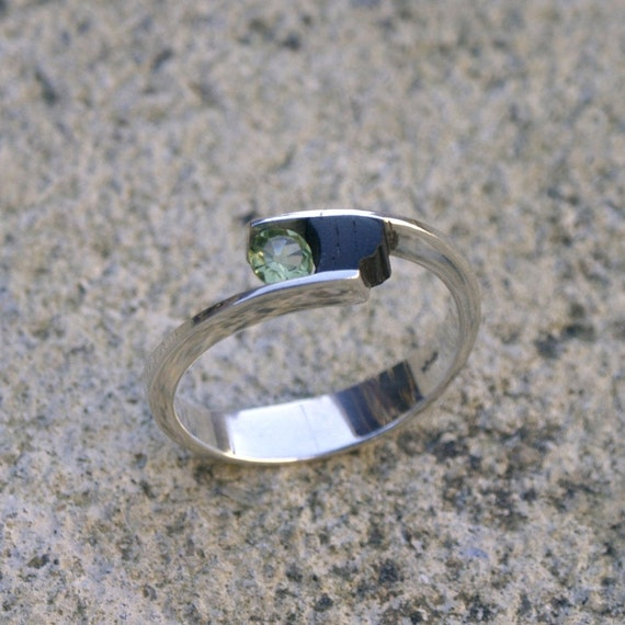 Black ebony wood and Sterling silver with a 4 mm moss green faceted peridot