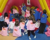 TEN Capes - smaller size, one side applique, one panel, velcro fastening.  Perfect for Party Favors