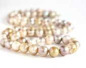 Long hand knotted natural color pearls