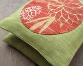 pair of balsam fir sachets / red lotus flowers on green carnelian linen