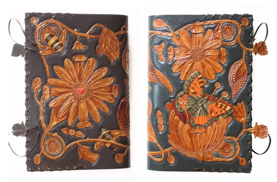 Hand carved and painted leather journal cover with butterfly emerging from a flower