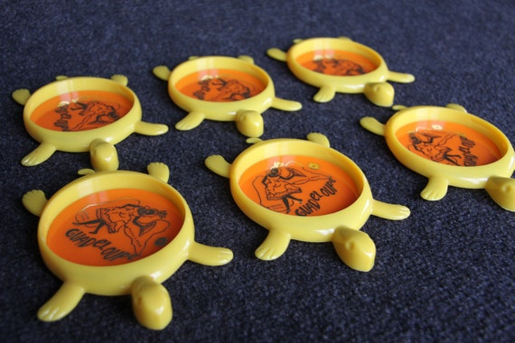 Yellow plastic souvenir turtle coasters from Guadeloupe