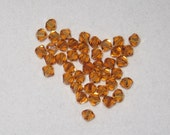 TOPAZ Bicone Chinese Crystals - 100 crystals