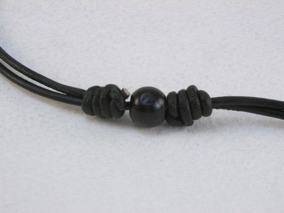 knotted black leather cord choker necklace with black glass bead 1925