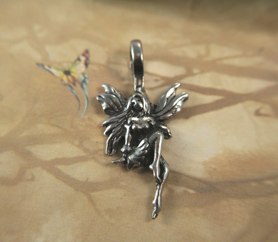 Lovely Sitting Fantasy Fairy Pendant lead safe pewter charm