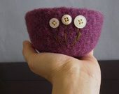 fuzzy felted purple wool bowl with three cream flowers