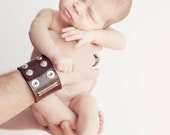 Cool Daddio - A customized leather cuff with two copper and sterling tags