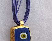 Evil Eye 14 Karat Gold Waved Organic Cotton Necklace