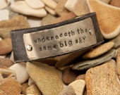 Underneath the same big sky leather cuff