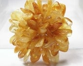 Baltic amber brooch, handmade of a polished amber pieces. EJ1