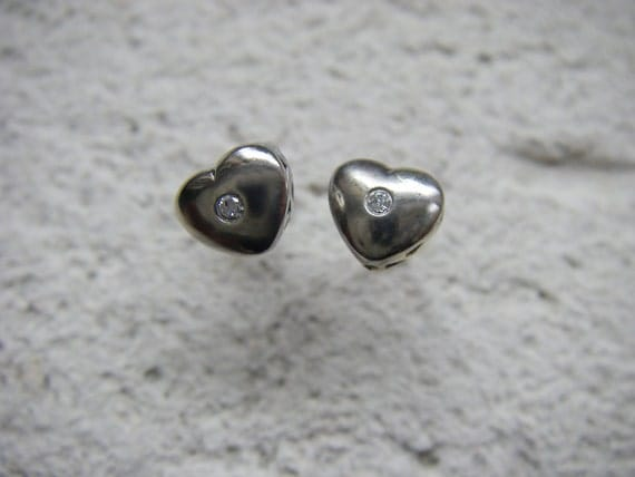 White gold heart stud earrings with diamonds