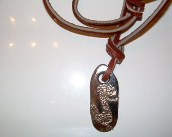 Brass Dragon on fossilized polished bone