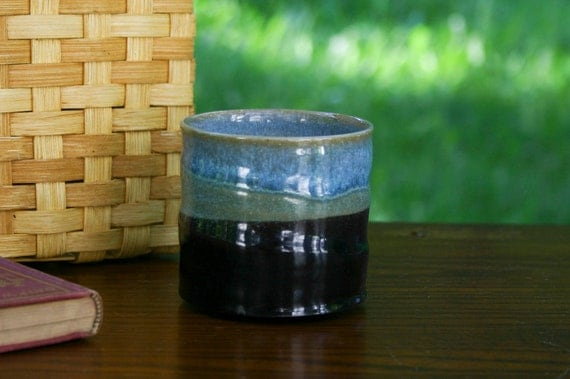 black and teal cup