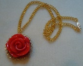 Gold plated chain with a Red resin rose pendant on a vintage finding