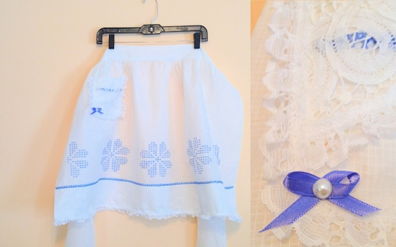 Vintage White Lace Half Apron. Cotton. Blue. White. Lace. Bow. Feminine. Romantic. Homemaker. Cooking. Serving. Frilly. Adjustable. 1970s.