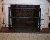 Fireplace screen with fish handles