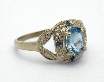 Delicate vintage-look ring in 14K yellow gold with blue topaz